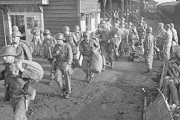 1st Units of doomed Task Force Smith enter Taejon